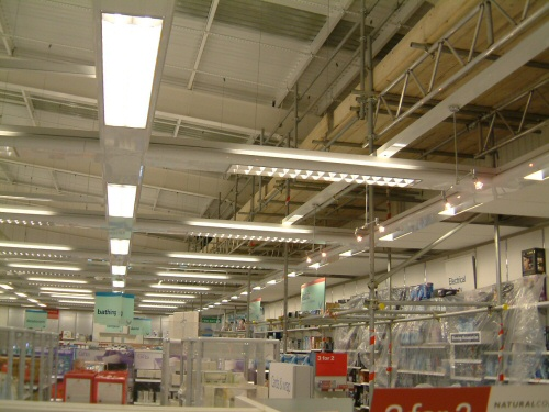 Scaffolding inside Boots Chemist at Reebok, Bolton to allow adding of fire protection to steelwork frame