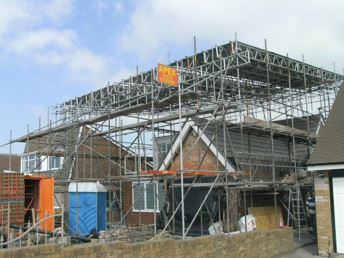 Temporary roofing scaffolding erected to a bungalow near Knott End-on-Sea, Lancashire