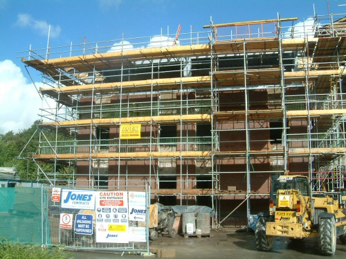 Scaffolding for new build of a large brick office block near Manchester